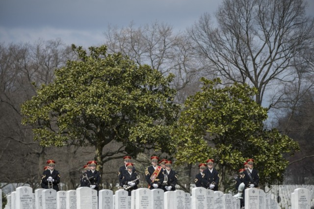 """The U.S. Army Band, """"Pershing's Own"""" helps helps conduct military funeral honors with funeral escort for U.S. Army Air Forces Capt. Lawrence Dickson in Section 60 of Arlington National Cemetery, Arlington, Va., March 22, 2019."""