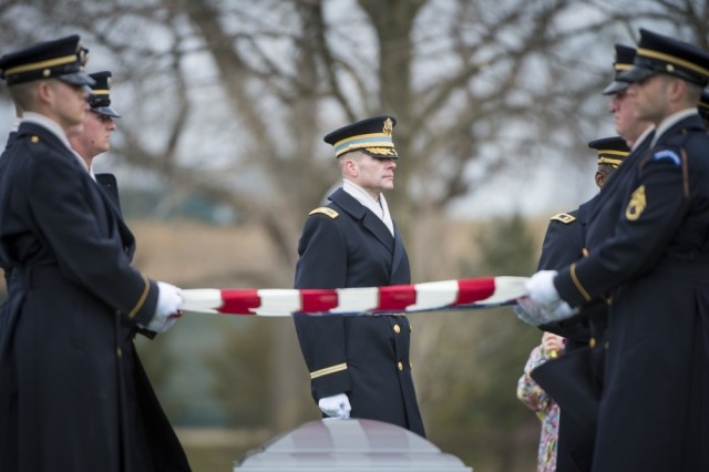 Soldiers from the 3d U.S. Infantry Regiment (The Old Guard); U.S. Army Col. James Tuite (center), regimental commander, 3d U.S. Infantry Regiment (The Old Guard); helps conduct military funeral honors with funeral escort for U.S. Army Air Forces Capt. Lawrence Dickson in Section 60 of Arlington National Cemetery, Arlington, Va., March 22, 2019.