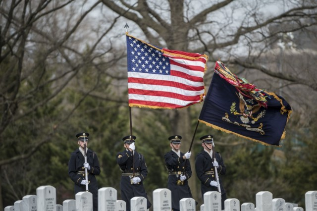 A color guard from the 3d U.S. Infantry Regiment (Old Guard) helps conduct military funeral honors with funeral escort for U.S. Army Air Forces Capt. Lawrence Dickson in Section 60 of Arlington National Cemetery, Arlington, Va., March 22, 2019.