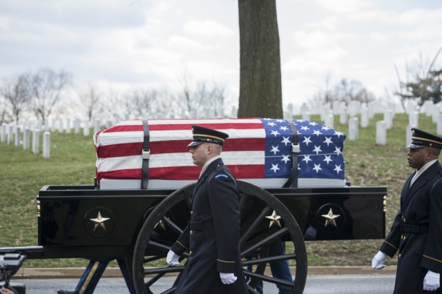 The 3d U.S. Infantry Regiment (The Old Guard) Caisson Platoon helps conduct military funeral honors with funeral escort for U.S. Army Air Forces Capt. Lawrence Dickson in Section 60 of Arlington National Cemetery, Arlington, Va., March 22, 2019.