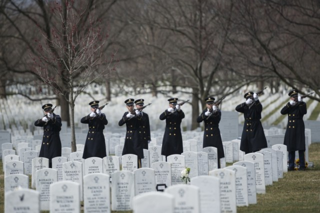 The firing party from the 3d U.S. Infantry Regiment (The Old Guard) fires a 3-rifle volley as part of military funeral honors with funeral escort for U.S. Army Air Forces Capt. Lawrence Dickson in Section 60 of Arlington National Cemetery, Arlington, Va., March 22, 2019.
