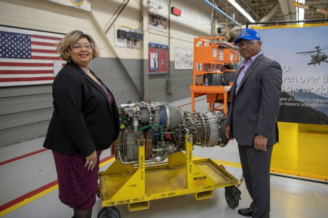Malissa Blake and Chris Young, both contracting officers with the U.S. Army Aviation and Missile Command, Redstone Arsenal, Alabama, stand aside a General Electric T700 engine during a ceremony at Corpus Christi Army Depot, Texas, March 14, 2019. CCAD celebrated completing 10,000 T700 engines in partnership with GE. Over 20 thousand engines and other helicopter parts have been processed through CCAD during the lifetime of the partnership, which began in 2000.