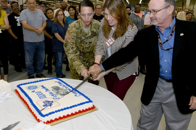 From left to right, Col. Gail Atkins, commander, Corpus Christi Army Depot, Texas; Cristina Seda-Hoelle, general manager, military customer services, General Electric Aviation; and Tim Hillenburg, director of engine production, CCAD, cut a ceremonial cake during a ceremony at CCAD, March 14, 2019. CCAD celebrated completing 10,000 T700 engines in partnership with GE. Over 20 thousand engines and other helicopter parts have been processed through CCAD during the lifetime of the partnership, which began in 2000.