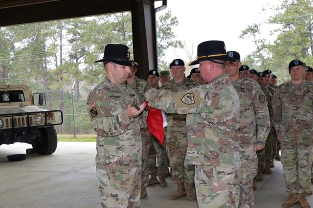 FORT BENNING, Ga. -- The 3rd Squadron of the 16th U.S. Cavalry Regiment unfurled four new guidons with the reactivation of Troops M, N, and P as well as Company D of the 4th Ranger Training Battalion in a ceremony held March 12 at Camp Cornett at Harmony Church at Fort Benning. (U.S. Army photo by Sgt. Scott Peckham, 3rd Squadron, 16th U.S. Cavalry Regiment)