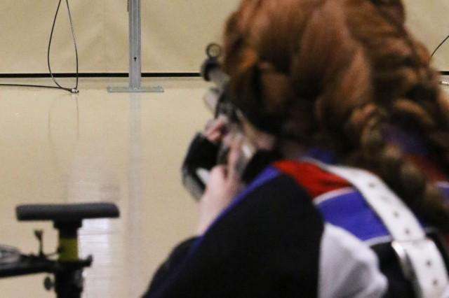 JROTC Cadet MacKenzie Nicholson, Fountain Fort Carson High School, Colorado, lines up a shot during the 2019 JROTC National Air Rifle Championships March 23.