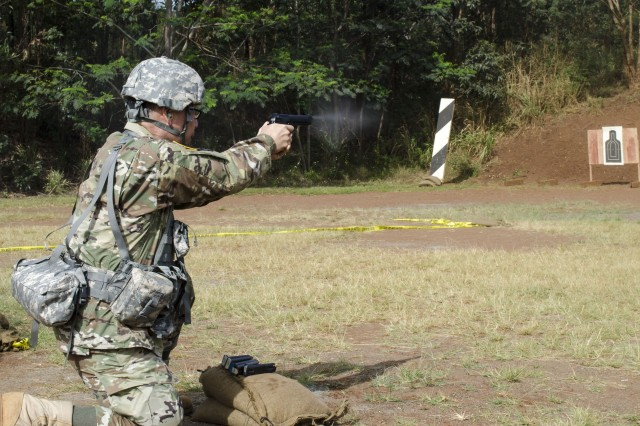 A Soldier assigned to U.S. Army Pacific-Support Unit, 9th Mission Support Command, Army Reserve, fires an M9 pistol for familiarization and qualification during a battle assembly at Schofield Barracks, HI, March 24, 2019. Generally, weapons qualification is an annual requirement for the Army Reserve.