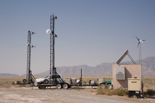 Instrument towers at Dugway Proving Ground, Utah are moved about the test grid with a light truck. Once in place, the tower with its instrumentation is raised. The tan box is for fiber optics, transmitting test data at near real-time for archive, format conversion and monitoring by test operators. U.S. Army photo