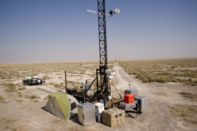 A mobile, 10-meter instrumentation tower ready for testing with instrumentation for meteorology, infrared, referee chemical or biological detectors, etc. Each trailer carries an electrical generator, data storage and communications for rapid transmission of data in near real-time. U.S. Army photo