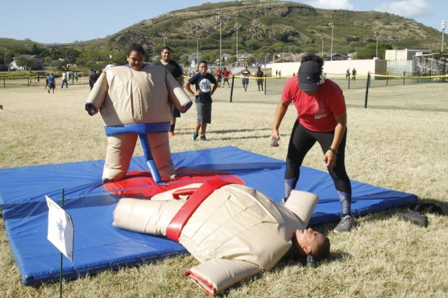 Pita and Lopeti Jr. daughter and son of SFC Siniva Filo, 8th STB, HHC, IG, battle it out in Sumo Suit Wrestling at this years Org. Day. Lopeti Jr. is defeated by older sister Pita.  (Army Photo by Staff Sgt. John Portela)