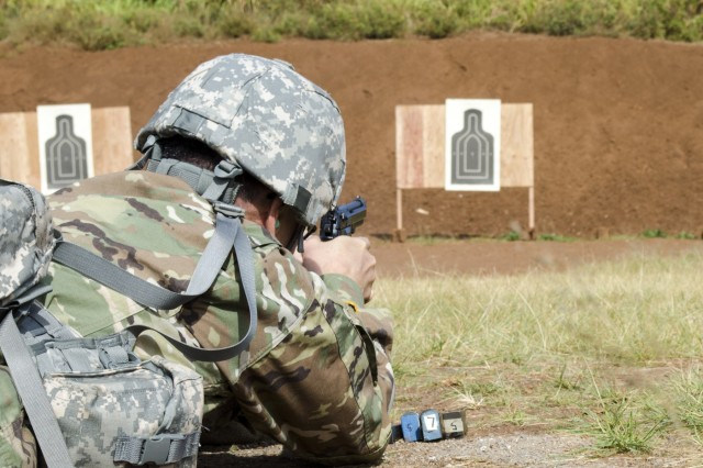A Soldier assigned to U.S. Army Pacific-Support Unit, 9th Mission Support Command, Army Reserve, fires an M9 pistol for familiarization and qualification during a battle assembly at Schofield Barracks, Hawaii, March 24, 2019. Generally, weapons qualification is an annual requirement for the Army Reserve.