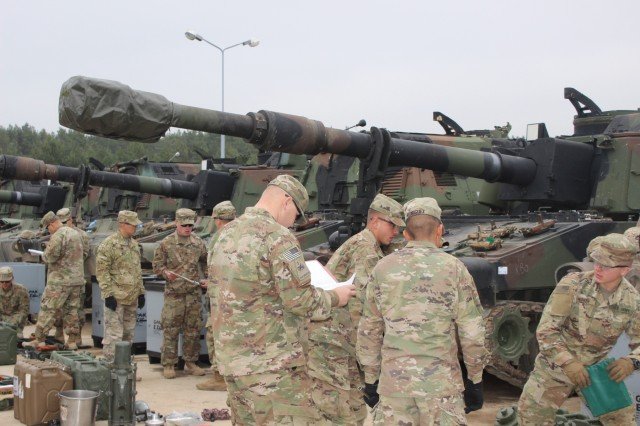 Soldiers with the 4th Battalion, 27th Field Artillery Regiment, 2nd Armored Brigade Combat Team, 1st Armored Division, conduct inventories during a draw of Army Prepositioned Stocks-2 equipment at Drawsko Pomorskie Training Area, Poland, March 21.