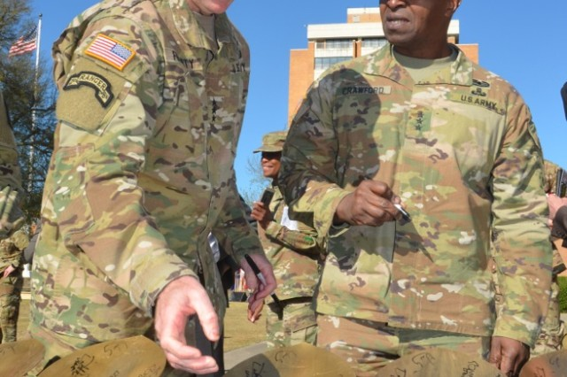 Autographing shovels used by the U.S. Army Cyber Command (ARCYBER) groundbreaking ceremony held March 27 are ARCYBER Commander Lt. Gen. Stephen Fogarty and Army Chief of Information Officer Lt. Gen. Bruce Crawford.