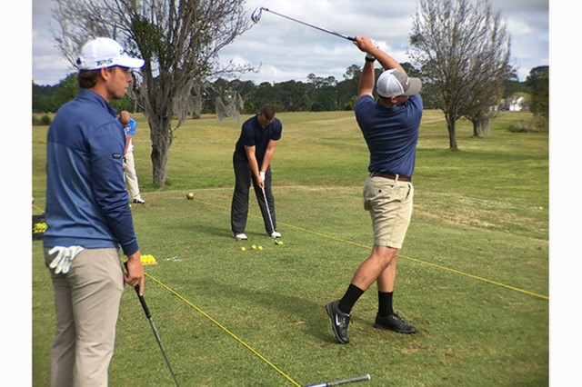 Spc. Blake Majors, 92nd Engineer Battalion, gets tips from Savannah Golf Championship professional golfer Mark Silvers of Savannah, March 26 on Fort Stewart.