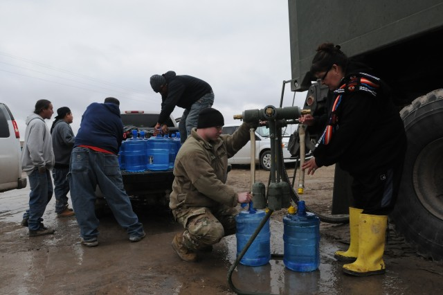 U.S. Army Spc. Keith German, Company A, 139th Brigade Support Battalion, South Dakota Army National Guard, provide drinkable water for residents of Wounded Knee on the Pine Ridge Reservation, S.D., March 25, 2019. Thirteen SDARNG Soldiers were activated for state duty in Pine Ridge after a county waterline failed due to extreme flooding leaving residents in seven communities without water in their homes.
