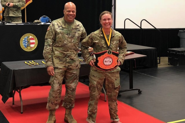 First Lt. Valerie Stearns stands with Maj. Gen. John C. Harris Jr., then-Ohio assistant adjutant general for Army, after she won the lightweight division championship at the 2018 Ohio Army National Guard Combatives Tournament Aug. 19, 2018, at the Maj. Gen. Robert Beightler Armory in Columbus, Ohio. With a warrior spirit and a heart for developing young minds, Stearns is stepping out of her comfort zone to grow as a Citizen-Soldier in the Ohio National Guard.