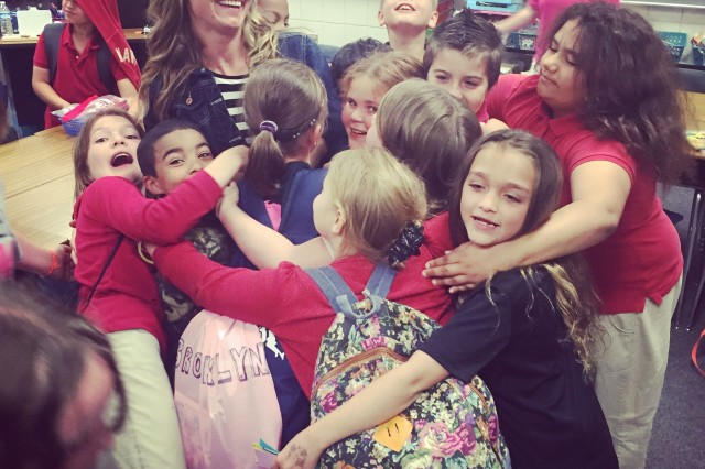Valerie Stearns gets an end-of-the-year hug from her third-grade class at Fostoria Elementary School in Fostoria, Ohio. In addition to being a first lieutenant in the Army National Guard, Stearns is also a licensed elementary school teacher. With a warrior spirit and a heart for developing young minds, Stearns is stepping out of her comfort zone to grow as a Citizen-Soldier in the Ohio National Guard.