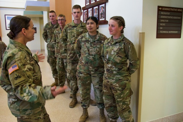 FORT BENNING, Ga. -- Martin Army Community Hospital Command Sgt. Maj. Rebecca Booker, left, talks to Soldiers of the Sullivan Memorial Blood Center. Military and civilian staff of the Sullivan Memorial Blood Center at Fort Benning briefed Maneuver Center of Excellence Commanding General Maj. Gen. Gary M. Brito on the center's contributions and capabilities in relation to the Armed Services Blood Program during his visit to the facility March 22, 2019. The ASBP is the official blood collection, manufacturing and transfusion program for the U.S. military, and provides blood products and services for all worldwide customers in both peace and war. (U.S. Army photo by Megan Garcia, Fort Benning Maneuver Center of Excellence Public Affairs)