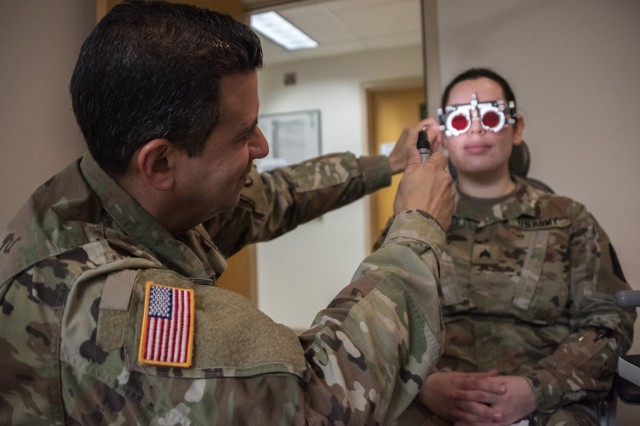 U.S. Army Col. (Dr.) Frank Valentin, chief of ophthalmology, checks a patient for double vision and convergence at Brooke Army Medical Center, Fort Sam Houston, Texas, Jan. 17, 2019. The Ophthalmology Clinic is open to all eligible beneficiaries.