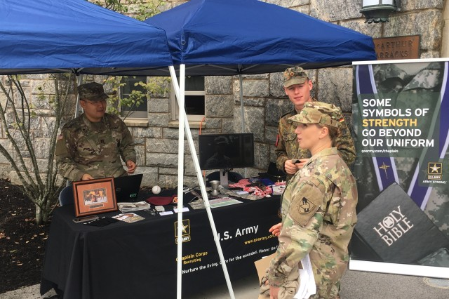 Capt. Delana Small (right), chaplain for the 3rd Regiment, Corps of Cadets, U.S. Military Academy, helps man an informational booth for West Point Branch Week in 2018.