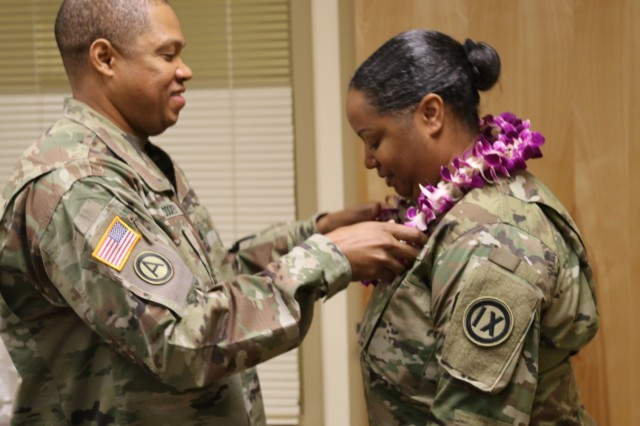 FORT SHAFTER FLATS, Hawaii - Master Sgt. Clifton Dockery, 9th Mission Support Command Equal Opportunity Advisor, presents Chief Warrant Officer Catrina Hale 4, 9th Mission Support Command Senior Legal Advisor, with a lei as a symbol of gratitude for speaking at the 2019 9th Mission Support Command Womens' History Month panel event. Hale was joined by fellow female Army Reserve leaders Col. Patricia Wallace, commander of the U.S. Army Pacific - Support Unit and 9th MSC Command Sgt. Maj. Jessie Baird.