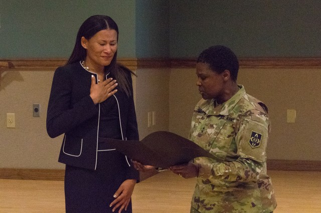 Maj. Gen. Donna Martin, Maneuver Support Center of Excellence and Fort Leonard Wood commanding general, presents a certificate to Marie-Christine Williams.