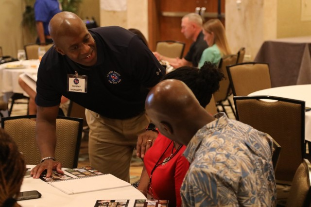 Sergeant Maj. Murphy Morissette, with the U.S. Army Pacific Chaplains office, helps a couple at the first Executive Enlisted Strong Bonds retreat in downtown Honolulu, Hawaii March 23-24, 2019. The USARPAC chaplain's office is submitting their after action review (AAR) comments from the retreat to the Office of the Chief of Chaplains in hopes of making Executive Enlisted Strong Bonds retreats an army wide program.