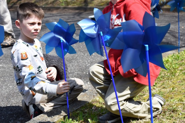 Gabriel Ragsdale, 8, plants a pinwheel for Child Abuse Awareness Month at Camp Zama Army Community Service March 27.