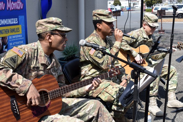 From left, Spc. Asher Askew, Staff Sgt. Dnard Edwards and Sgt. Trenton Frizzell, members of the U.S. Army Japan Band, play music during the Plant a Pinwheel for Child Abuse Awareness Month event at Camp Zama Army Community Service March 27.