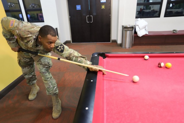 CAMP HUMPHREYS, Republic of Korea - Pvt. Shawn M. Grace, Youngstown, Ohio native, geospatial engineer, 2nd Infantry Division/ROK-U.S. Combined Division, plays a game of pool at the Pfc. Ross A. Ginnis Warrior Zone to relax after a long day at work, March 26. Soldiers enjoy the many amenities offered by both the Pfc. Ross A. Ginnis Warrior Zone and Recreation Center at little to no cost seven days a week. (U.S. Army photo by KATUSA Cpl. Park, Seung Ho, 2ID/RUCD Public Affairs)