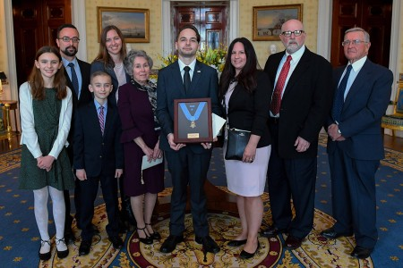 President Donald J. Trump posthumously awards the Medal of Honor to Staff Sgt. Travis W. Atkins at the White House in Washington D.C., March 27, 2019. Atkins was posthumously awarded the Medal of Honor for actions while serving with Delta Company, 2nd Battalion, 14th Infantry Regiment, 2nd Brigade Combat Team, 10th Mountain Division, in Abu Sarnak, Iraq, in support of Operation Iraqi Freedom, on June 1, 2007. His extraordinary heroism in attempting to subdue a suicide bomber and shielding three Soldiers from the imminent explosion resulted in him being mortally wounded and saving the Soldiers.