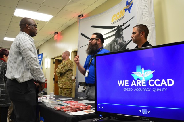 Aaron Hoss (blue shirt), electroplating branch chief, Corpus Christi Army Depot, Texas, speaks with a prospective job seeker about the many opportunities at CCAD during the DoD Hiring Heroes Career Fair at Fort Sam Houston, San Antonio, Texas, March 20, 2019. Hundreds of prospective employees had the opportunity to visit the booth and dozens others to learn more about current career opportunities both locally and nationally. This was just one of dozens of career fairs CCAD has attended as part of their human capital campaign to fill critical or hard-to-fill positions. (Photo by Brian Nestor, CCAD Public Affairs/Released).
