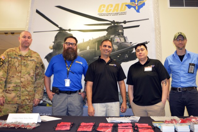 Corpus Christi Army Depot employees pose for a photo around the CCAD booth during the DoD Hiring Heroes Career Fair at Fort Sam Houston, San Antonio, Texas, March 20, 2019. Hundreds of prospective employees had the opportunity to visit the booth and dozens others to learn more about current career opportunities both locally and nationally. This was just one of dozens of career fairs CCAD has attended as part of their human capital campaign to fill critical or hard-to-fill positions. (Photo by Brian Nestor, CCAD Public Affairs/Released).
