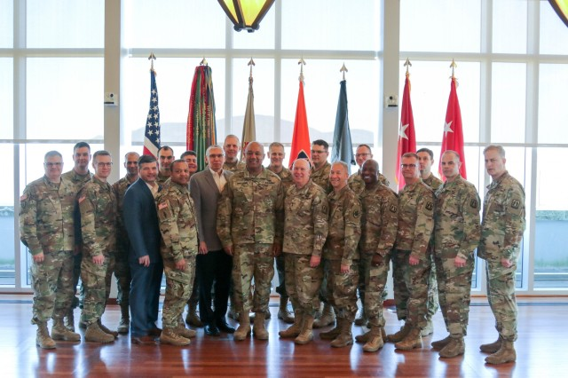 Lt. Gen. Darryl A. Williams, Superintendent of the U.S. Military Academy, and Maj. Gen. Peter A. Bosse, Commanding General of 335th Signal Command, sign a memorandum of agreement between The Army Cyber Institute at West Point and the 335th Signal Command's Army Reserve Cyber Operations Group. The memorandum formalizes a partnership between ACI and the 335th for 10 reserve Soldiers to work alongside active-duty Soldiers to improve the Army's cyber capabilities. (U.S. Army photo by Brandon O'Connor)