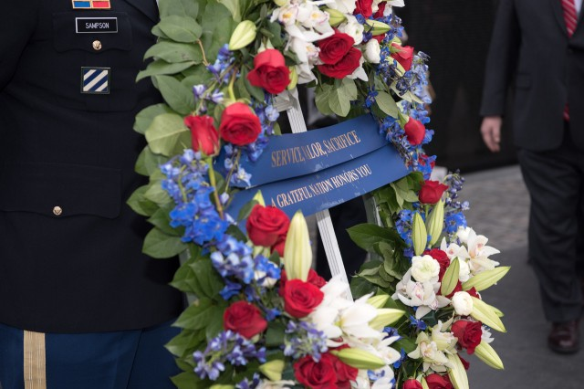 A wreath honors the second anniversary of National Vietnam War Veterans Day at the Vietnam War Memorial in Washington, March 29, 2019.