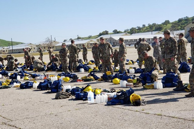 Cal Guard Soldiers are issued wildland firefighting gear March 25 at Camp Roberts.