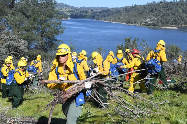 Cal Guardsmen in Task Force Rattlesnake remove brush during chainsaw training above Lake Nacimiento on California's Central Coast on March 29.