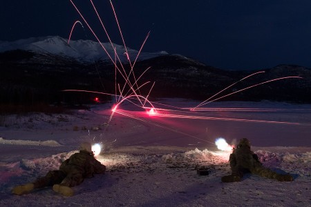 Soldiers fire M249 light machine guns at night during live-fire training at Grezelka range, Joint Base Elmendorf-Richardson, Alaska, March 4, 2019. Utilizing the M249 light machine gun and M240L machine gun, the Spartan paratroopers honed their marksmanship skills by engaging multiple targets at varying distances.