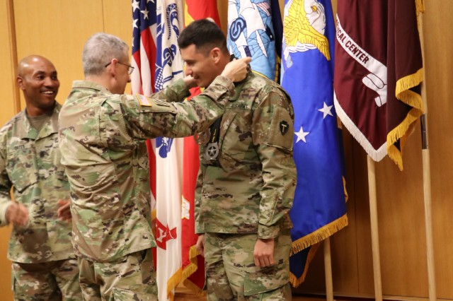 U.S. Army Sgt. Jorge Rodriguez, Brooke Army Medical Center, Warrior Transition Battalion, receives one gold, four silver and one bronze medal during a BAMC awards ceremony March 26. Rodriguez earned his medals participating in rowing, track, and swimming events at the 2019 Army Trials, hosted at Fort Bliss, Texas, March 5-16. The Army Trials is an adaptive sports competition with nearly 100 wounded, ill and injured active-duty Soldiers and veterans competing in 14 different sports for the opportunity to represent Team Army at the 2019 Department of Defense Warrior Games in Tampa, Florida.
