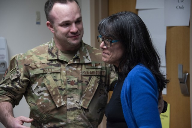 Air Force Maj. (Dr.) Matthew Read, acting Extracorporeal Membrane Oxygenation medical director, shares an emotional moment with former patient, Rita Ibanez, at Brooke Army Medical Center, Fort Sam Houston, Texas, March 22, 2019. Ibanez met with Read and other members of the ECMO team to thank them for the care she received in 2015.