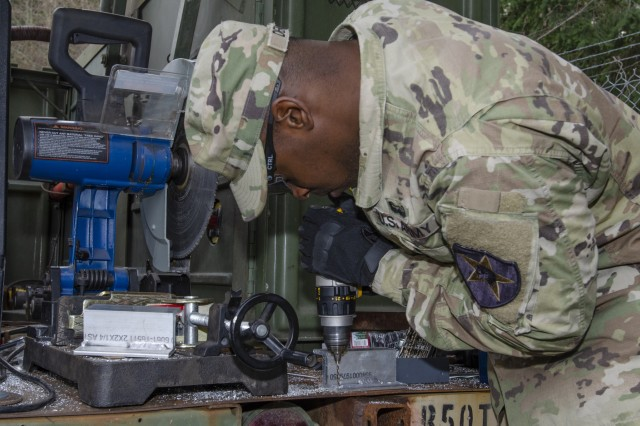 Spc. Quayshaun Denson, an allied trade specialist with 1-2 Stryker Brigade Combat Team, manufactures a bracket for use in an M1087 Expandable Van Shelter March 14, 2019, at Joint Base Lewis-McChord, Wash. These expando vans are being integrating into units such as the 1-2 SBCT to assess different configurations units construct for their operational needs. The van's overall design decreases setup and teardown time while increasing mobility of command posts so units can rapidly react to near-peer enemy threats. This is part of the Army's modernization strategy to make Soldiers and units more lethal to win the nation's wars.