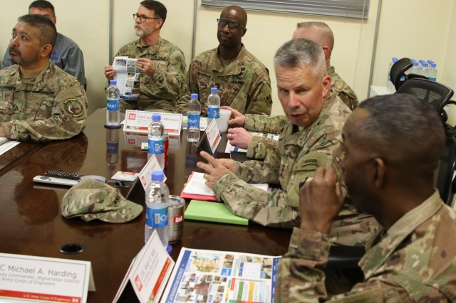 LTG Todd T. Semonite engages in a conversation with Afghanistan District Commander Jason Kelly during his visit in theater, while others in the district overview meeting look on.
