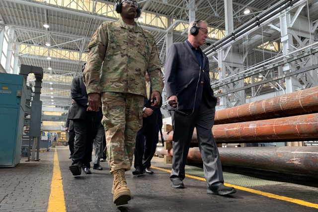 Watervliet Arsenal Commander Col. Milton Kelly, left, walks down the manufacturing line with American Legion National Commander Brett Reistad during a tour of the cannon manufacturing line at Watervliet Arsenal on March 28. The tour showcased some of the modernization and readiness efforts that have occurred recently at the arsenal.