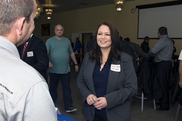 Angela Arwood-Gallegos, a Small Business Professional with the MICC Office of Small Business Programs, speaks with an exhibitor at Dugway Proving Ground, Utah, during its March 21 Small Business Vendors Fair. Photo by Al Vogel, Dugway Proving Ground Public Affairs