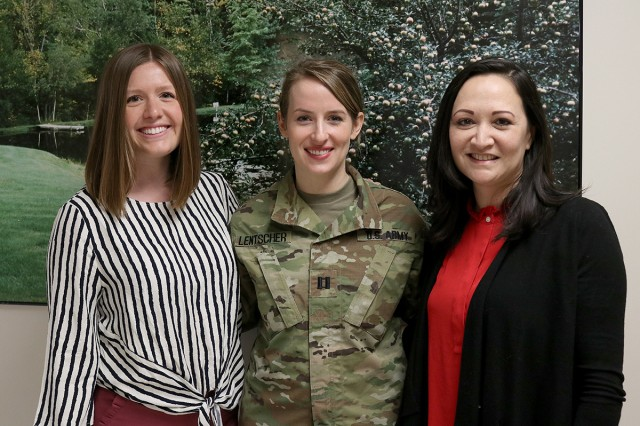 Capt. (Dr.) Jessica Lentscher, a second year fellow in reproductive endocrinology and infertility at Madigan Army Medical Center, is flanked by Seattle Reproductive Medicine's Hailey Baker (left), a weekend nurse lead, and Sarah Thompson, a physician liaison and educator, who aided Lentscher in providing Madigan oncology clinicians information on many facets of fertility past cancer treatment in a Mar. 21 presentation at Madigan on Joint Base Lewis-McChord, Wash.