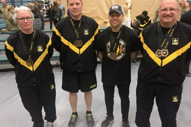 Sgt. 1st Class Ian Crawley, second from left, won two gold medals at the Army Trials held at Fort Bliss, Texas, March 6-15. Crawley made Team Army and will travel with other wounded, ill or injured warriors to represent the Army at the Department of Defense Warrior Games in June in Tampa, Fla.