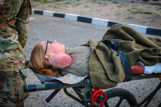 A mock casualty lies on stretcher during the Golden Trident mass casualty training exercise at Camp Arifjan, Kuwait, March 21, 2019. (U.S. Army photo by Sgt. Nahjier Williams)
