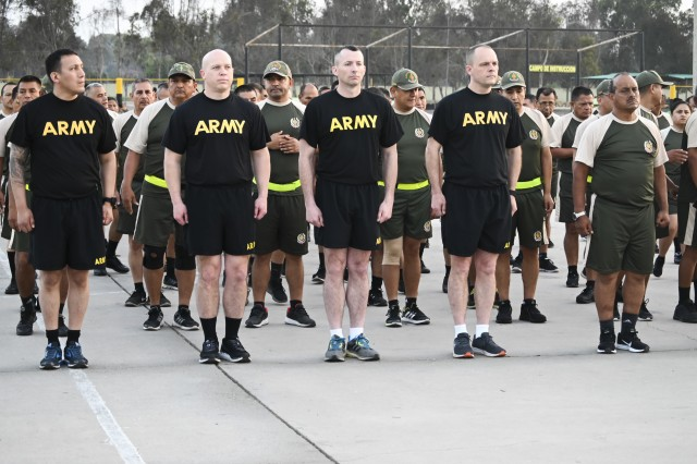 Members of the West Virginia National Guard stand at attention prior to starting a physical training session with the Peruvian Army March 27, 2019, in Lima, Perú. Members of the West Virginia National Guard provided a week-long training on non-commissioned officer (NCO) development planning and implementation for the Peruvian Army's senior NCOs.