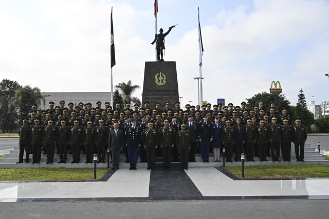 """Members of the West Virginia National Guard pose for a photo with the senior enlisted leaders of the Peruvian Army following the """"Day of the Peruvian Army Non-Commissioned Officer"""" March 26, 2019, in Lima, Perú. The West Virginia National Guard joined PERAR NCOs as they were independently recognized for the first time for their contributions to Peru's defense."""