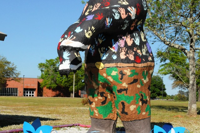 Fort Rucker children gave Sgt. Ted E. Bear a new paint job to help the post kick off its month-long observance of National Child Abuse Prevention Month.