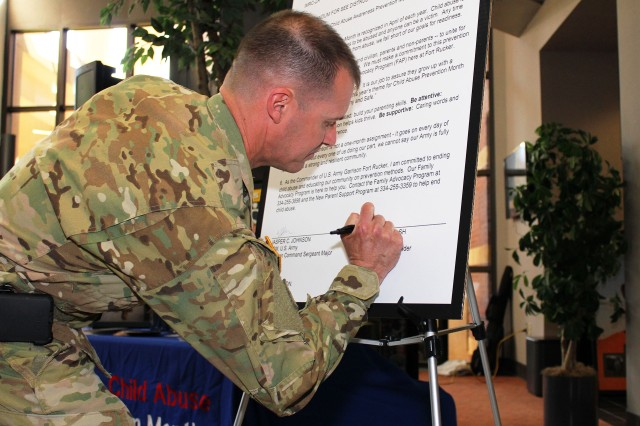 Col. Brian E. Walsh, Fort Rucker garrison commander, in honor of Child Abuse Prevention Month and Month of the Military Child, signed a proclamation during a ceremony in the atrium of Bldg. 5700 April 2 to pledge his and the installation's commitment to ending child abuse.